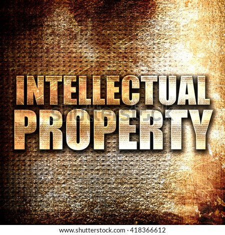 intellectual property, rust writing on a grunge background - stock photo