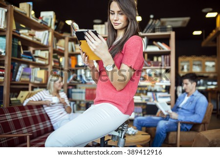 Intellectual students reading books in library