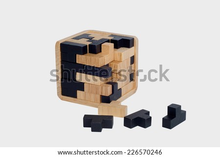 Intelligence game made with wooden pieces. Logic puzzle - stock photo