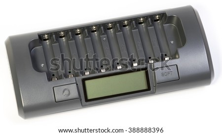 Intelligent battery charger, isolated on white backgroungd. Intelligent battery charger for 8 accumulators. - stock photo