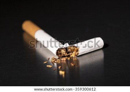 Intenational day : do not smoke today, May 31 - 2016 Broken cigarette on black background, reflected, stop smoking - stock photo