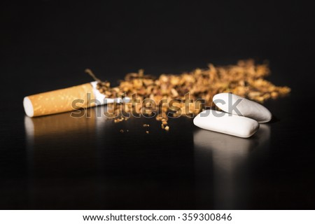 Intenational day : do not smoke today, May 31 - 2016.  End of flavored plug wrap cigarette Broken cigarette on black background, reflected, stop smoking, with gum - stock photo