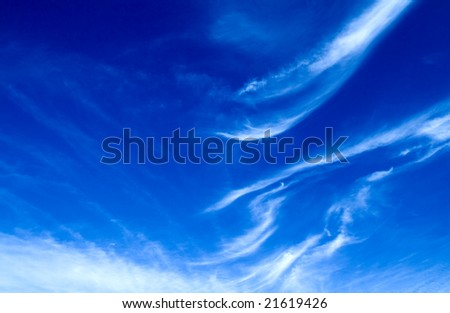 Intense blue sky with nice peaceful clouds - stock photo