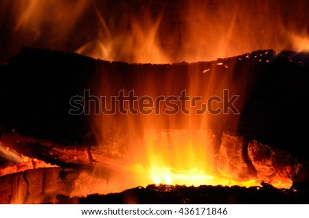 intense burning fire in fireplace in cold winter