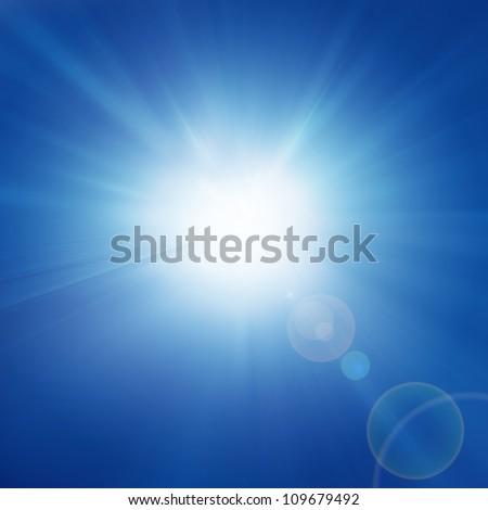 Intense sun on a soft blue background - stock photo