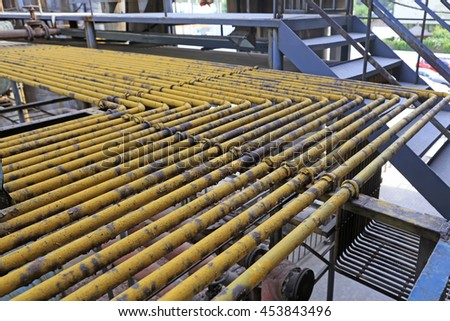 Intensive oxidation rust yellow steel pipe, closeup of photo