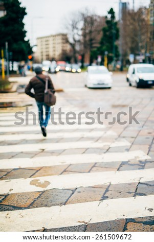 intentional blurred city and people urban milan scene background   - stock photo