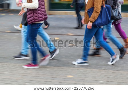 intentional motion blur picture of walking people the pedestrian zone of a city - stock photo