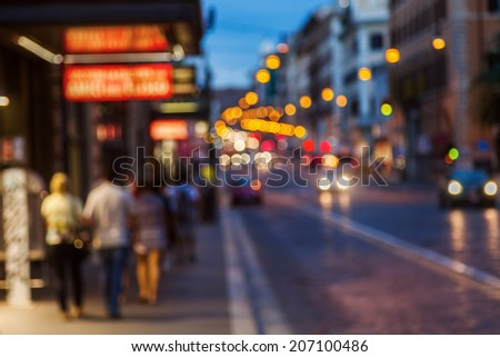 intentional out of focus picture of a city scene at night with traffic lights  - stock photo