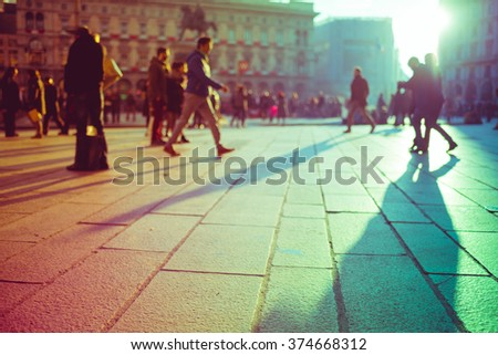 Intentionally blurred filtered vintage of defocused people walking outdoor on the sidewalk in the city - commute, work concept - stock photo