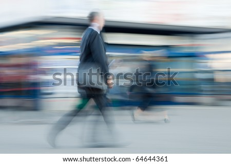 Intentionally blurred image of businessman rushing to office in the morning - stock photo