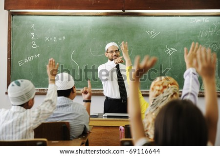 Interaction between teacher and children. Activity and happiness, competition, rising arms. - stock photo