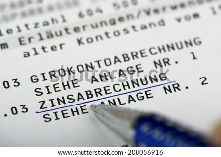 Interest settlement on a bank statement written in German Language Zinsabrechnung auf einem Kontoauszug  - stock photo