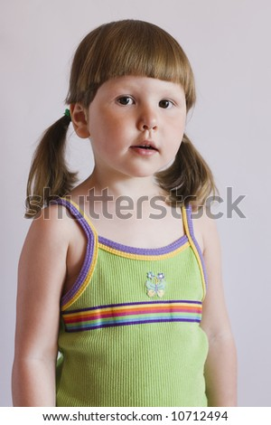 Interested little girl with ponytails in green top
