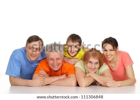 Interesting family having fun in bright T-shirt on a white background