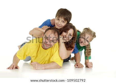 Interesting family of four in bright T-shirt on a white background