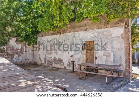 Interesting interior walls with a canopy of trees make a lovely spot for a picnic
