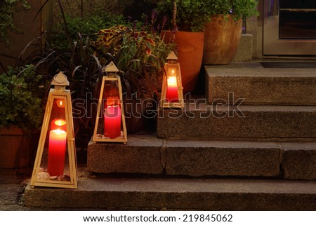 Interesting lighting decor by the entrance of the restaurant - stock photo