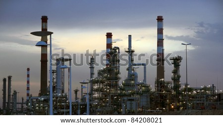 Interesting panorma of an oil refinery near a road  in the early morning light (dawn)