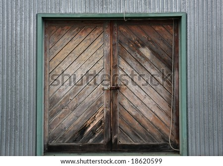 Interesting pattern of old wooden doors on a corrugated iron building & Interesting Pattern Old Wooden Doors On Stock Photo 18620599 ...