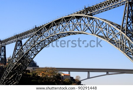 Interesting perspective of two of the many bridges of Porto, a modern bridge made ??of concrete and the old iron bridge D. Mary - stock photo