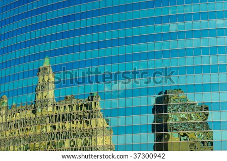 Interesting reflections in a curved building wall in Chicago - stock photo