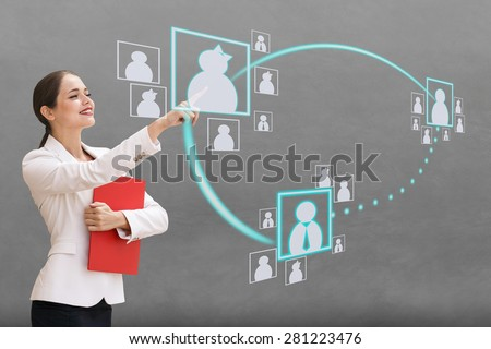 Interface, a woman on gray background pushing on virtual buttons.  - stock photo