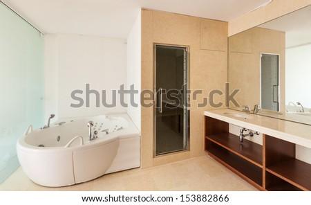 Interior apartment, view bathroom with jacuzzi - stock photo