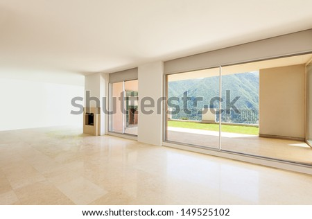 Interior apartment with garden, large room with windows - stock photo