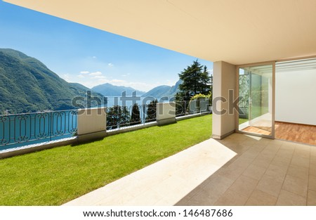 Interior apartment with garden, view from veranda - stock photo