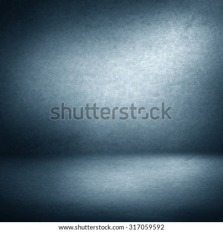 interior background, blue suede background and beam of lights, empty room as grunge background texture - stock photo