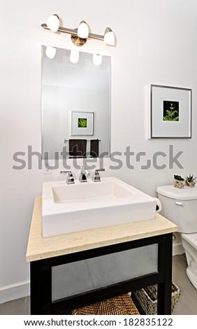 Interior bathroom vanity and mirror - artwork on walls are from photographer portfolio - stock photo