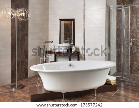 interior bathroom with tub and shower - stock photo