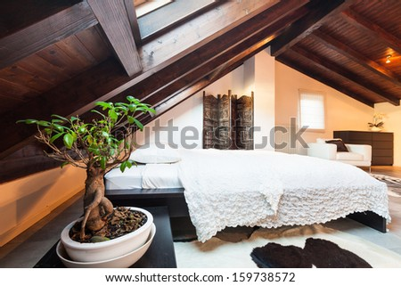 Interior, beautiful loft, luxurious bedroom - stock photo