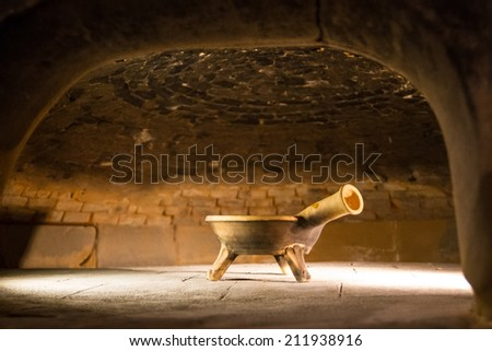 Interior chamber of an ancient, open front brick oven.