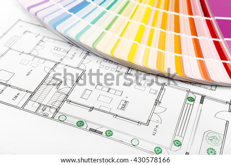interior color selection - paint samples with house floor plan - stock photo