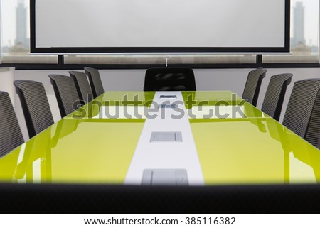 Interior conference room, meeting room, with white projector board. - stock photo