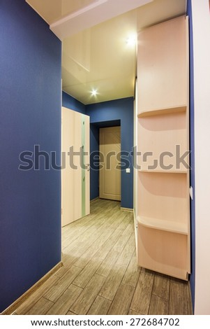 interior corridor with wooden floors and artificial lighting - stock photo
