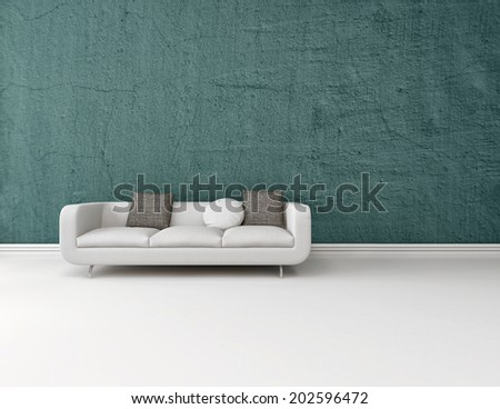 Interior decor background with a modern generic white sofa on a blue wall with a white floor with a skirting board and plenty of copy space - stock photo
