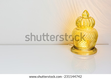 Interior decor: Lamp on the table with a white wall and copy space - stock photo