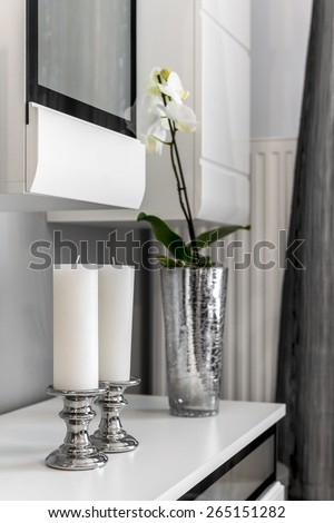 Interior decoration detail - white candles in silver holder - stock photo