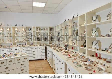 Interior decoration of jewelry store with exhibition display shelfs - stock photo