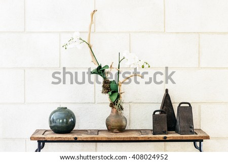 Interior decorative arrangement ornament with orchid bells and ceramic ball