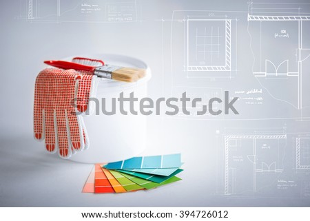 interior design and home renovation concept - paintbrush, paint pot, gloves, pantone samplers and blueprint - stock photo