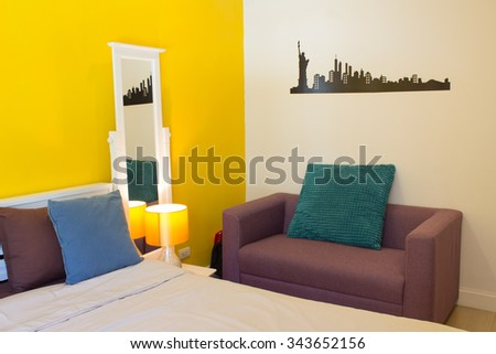 Interior Design, Beauty Living space: Sofabed, White Wooden bedside table and reading lamp, Living space in Bedroom./ Interior Design: Relaxing colorful living space in bedroom. - stock photo