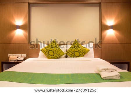 Interior design: Bed with light in hotel - stock photo