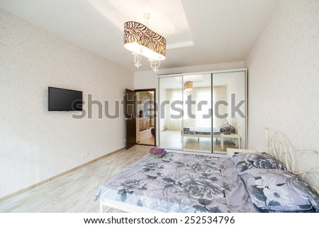 Interior design big modern Bedroom with bed and TV - stock photo