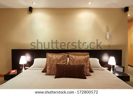 Interior design: Big modern elegant Bedroom with big empty wall - stock photo