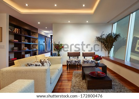 Interior design: Big Modern Living room with big empty white wall - stock photo