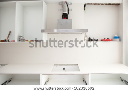 Interior design construction of a kitchen with cooker extractor fan hood - stock photo